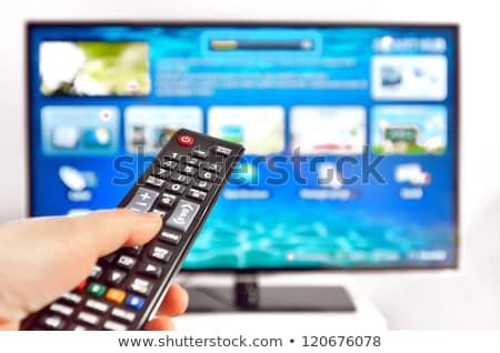 Smart Tv And Hand Pressing Remote Control ストックフォト © mady70