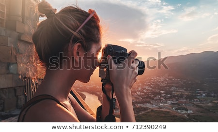 Woman taking pictures of a river Stock photo © IS2