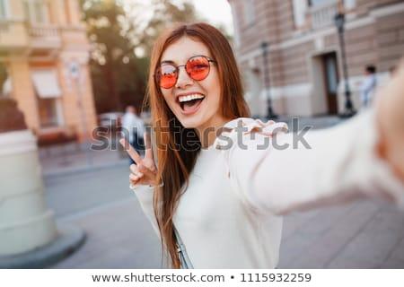 portrait of two smiling girls posing outdoor stock photo © neonshot