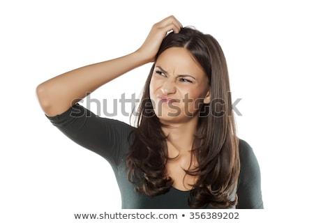 Confused caucasian girl scratching head. Stock photo © RAStudio