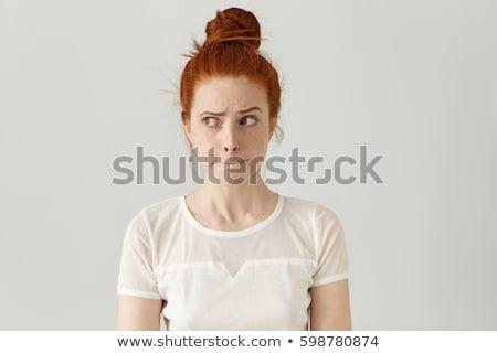 Retrato confuso mulher jovem em pé brasão dobrado Foto stock © deandrobot