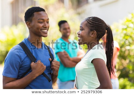 Smiling african boy with her girlfriend Stock photo © Kzenon