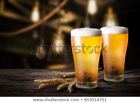 Glass of Beer and Wheat, Refreshing Alcohol Drink Stock photo © robuart