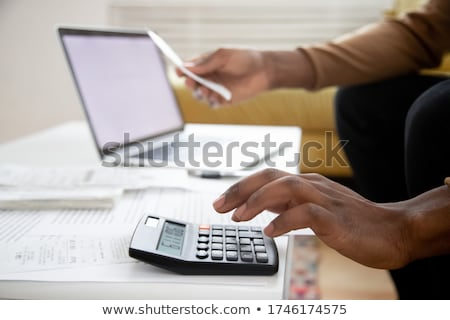 Invoice. Financial calculations. Working process. Businessman hands, calculator, financial reports,  Stock photo © makyzz