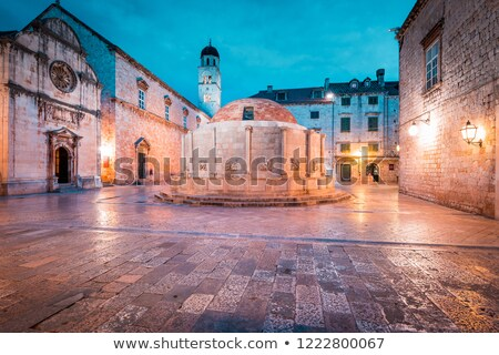 onofrio fountain and stradun street in dubrovnik evening view stock photo © xbrchx