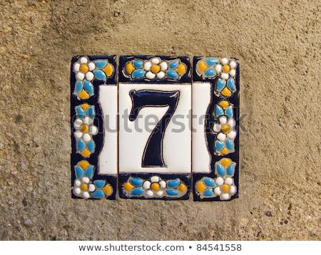 Assinar casa número teste padrão de flor parede de tijolos parede Foto stock © boggy