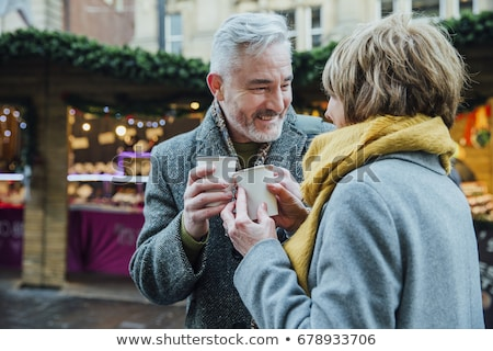 Stock photo: Couple with food and drink on Christmas market