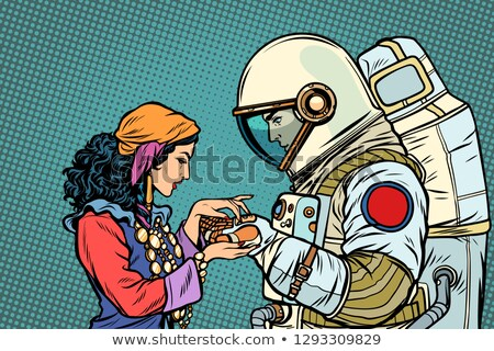 The fortune teller, and an astronaut. Palmistry by hand Stock photo © studiostoks