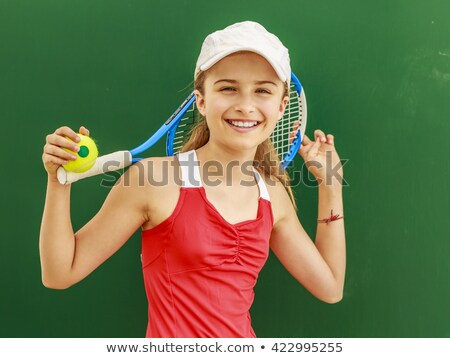 smiling teenage girl with tennis racket Stock photo © dolgachov