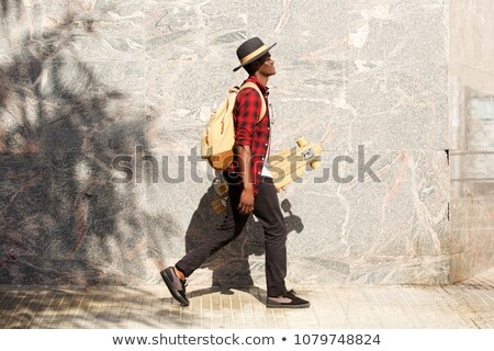 attractive man walking on the side of the road Stock photo © feedough