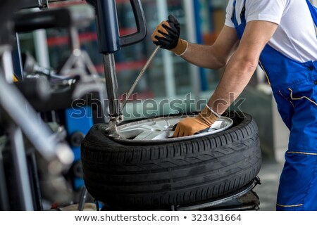 car repair service mechanic repairman and tires stock photo © robuart