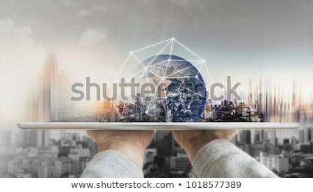 Comprimido global banco de dados mão escritório Foto stock © ra2studio