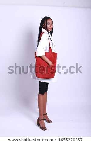 Fashionable girl with make up in elegant clothes holding red bag Stock photo © studiolucky