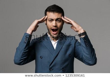 Aggressive schreien Geschäftsmann Kopfschmerzen posiert isoliert Stock foto © deandrobot