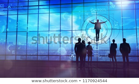 Business Angel in front of large windows Stock photo © ConceptCafe