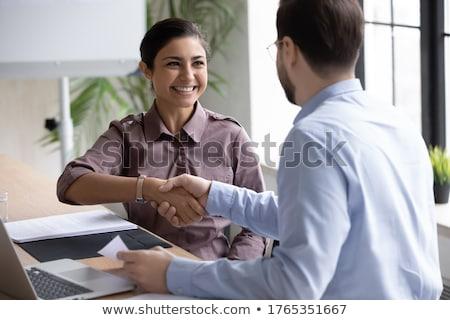 üzletember kezet fog női pályázó kilátás munkahely Stock fotó © AndreyPopov