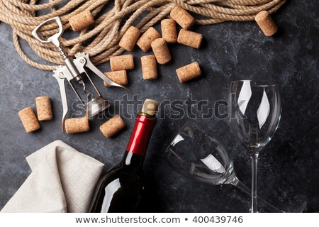 Wine glasses, corkscrews and corks Stock photo © karandaev