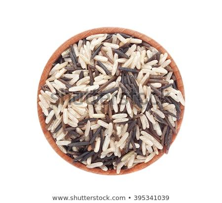Black bowl of raw organic basmati long grain and wild rice on white background. Healthy food.  stock photo © DenisMArt