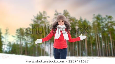 Stockfoto: Happy Woman In Fur Hat Over Winter Forest