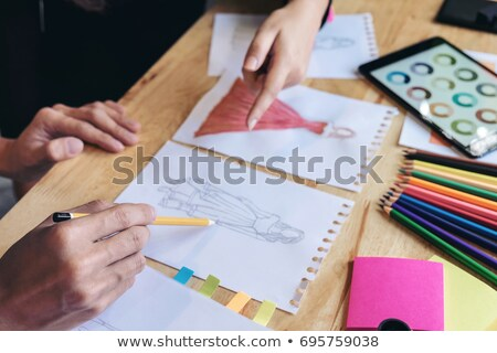 Close up of Two young dressmaker or designer colleagues's hands  stock photo © Freedomz