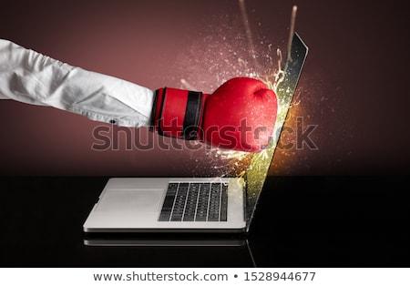 Arm hitting strongly laptop screen Stock photo © ra2studio