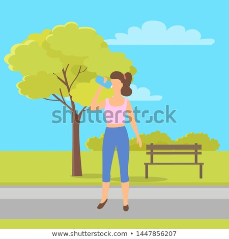 Sportive Woman Drinking Water. City Park and Bench Stock photo © robuart