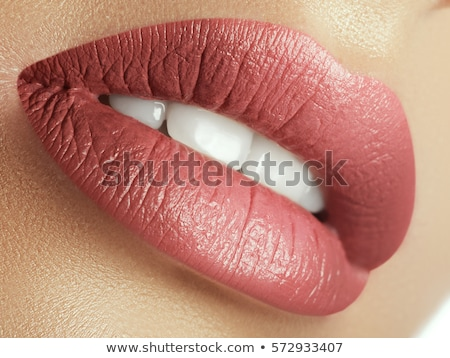 Close-up beautiful female lips with bright lipgloss makeup. Perfect clean skin, light fresh lip make Stock photo © serdechny