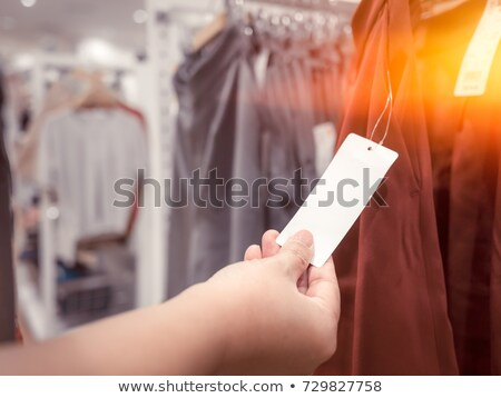 happy woman with price tags at clothing store stock photo © dolgachov