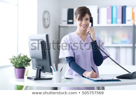 encantado · feminino · médico · falante · telefone · escritório - foto stock © dolgachov