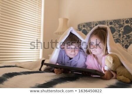 Elöl kilátás aranyos testvérek digitális tabletta Stock fotó © wavebreak_media
