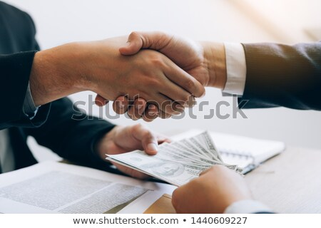 Two Businessmen Shaking Hands And Receiving Bribe Stock photo © AndreyPopov