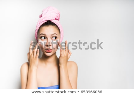 Happy beautiful woman with under-eye patches on face and towel on head Stock photo © pressmaster