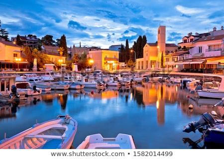 Város vízpart kikötő hajnal kilátás sziget Stock fotó © xbrchx