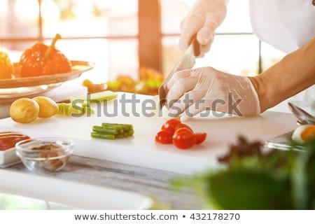 Szakács vág spárga női csíkok nő Stock fotó © Kzenon