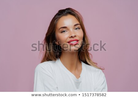 Portrait of smiling beautiful European woman with long hair, makeup, wears white casual jumper, feel Stock photo © vkstudio