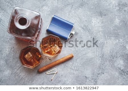 Two glasses of old whiskey with cuban cigar and carafe Stock photo © dash