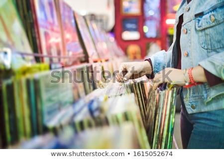 Fiatal nő választ klasszikus bakelit lp lemezek Stock fotó © diego_cervo
