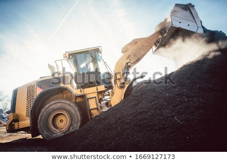 Bulldozer putting biomass on pile for composting Stock photo © Kzenon