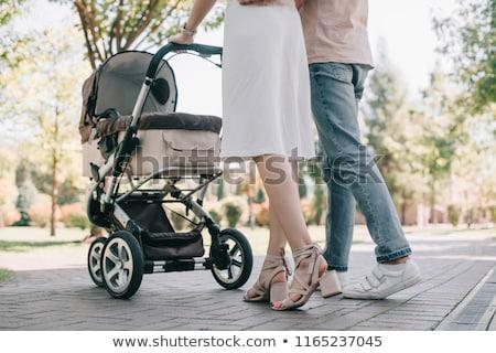 Matka ojciec dziecko baby rodziny wózki dla dzieci Zdjęcia stock © robuart