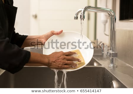 Dirty dishes in wash basin. Stock photo © papa1266