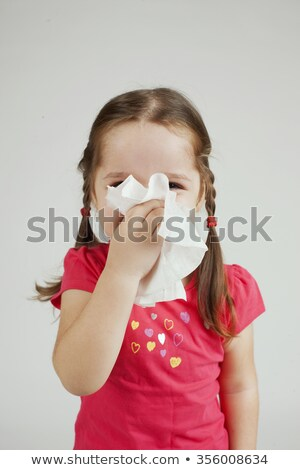girl is holding paper tissue and blowing nose Stock photo © choreograph