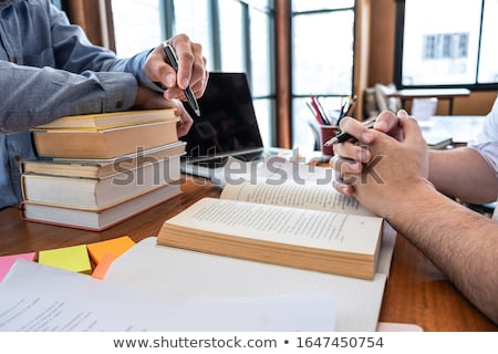 College tutor helps friend teaching and learning for a test or a Stock photo © snowing