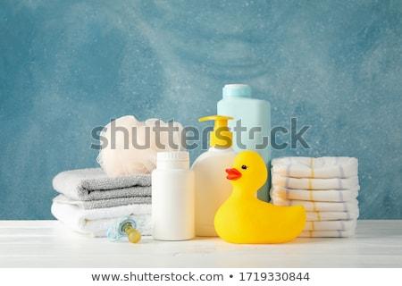 Bleu savon bouteille coloré serviettes Photo stock © tetkoren