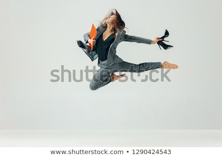business woman jumping in success stock photo © maridav
