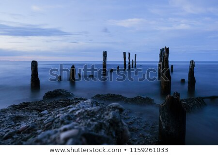 Stock photo: Wooden pole with sea in the background