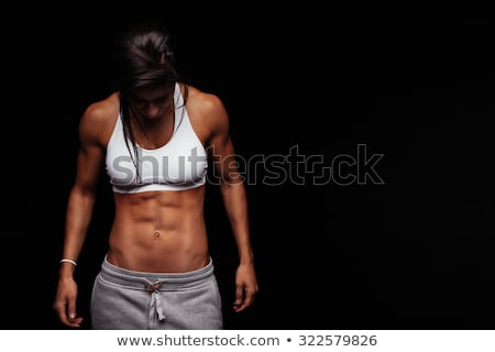 Fitness donna nero sport vestiti isolato bianco Foto d'archivio © dash