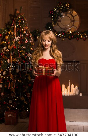 Blonde With Long Slender Legs In Red Dress Stock photo © stryjek