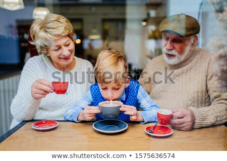 fiú · nagymama · étterem · nő · asztal · éjszaka - stock fotó © photography33
