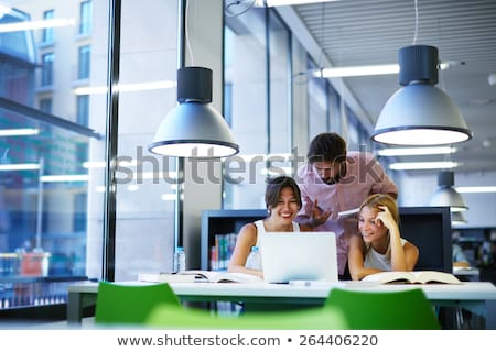 young man in architects office with laptop and plans stock photo © photography33