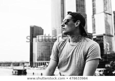 dinamikus · fotó · jóképű · fickó · pózol · város - stock fotó © konradbak